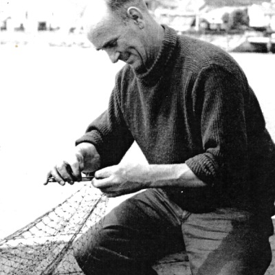 Historic photo of fisherman mending a net at Newlyn Harbour (Billy Stevenson Collection)