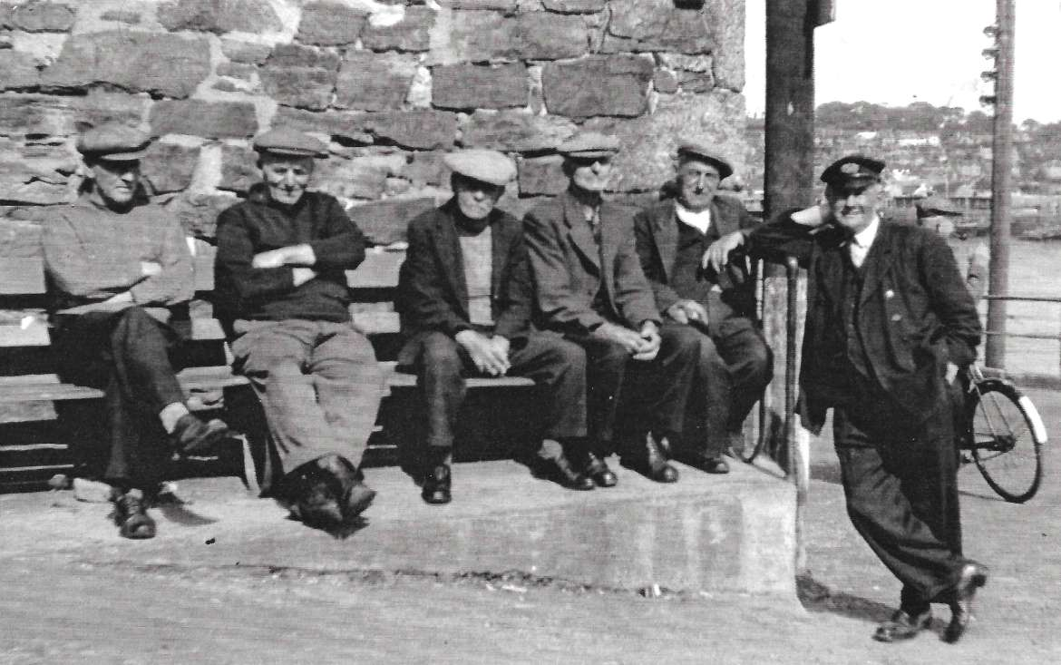 Old men sitting outside former Fishermen's Rest, Fore Street, Newlyn Town (Photo from Billy Stevenson Collection)