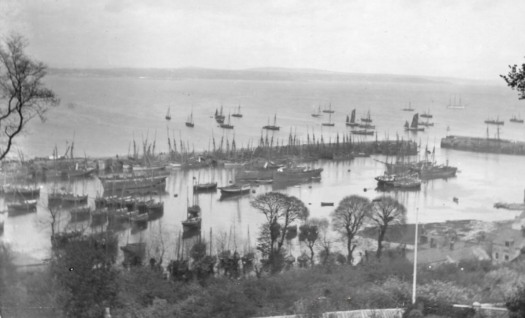 Historic general photo of Newlyn Harbour filled with different fishing and trading boats (Billy Stevenson Collection)