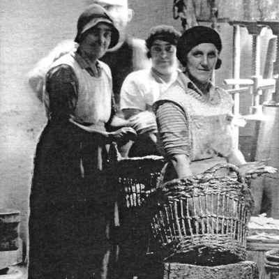 Newlyn women packing pilchards into barrels for pressing (photo from Billy Stevenson Collection)
